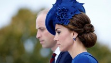 britains-prince-william-and-catherine-duchess-of-cambridge-pause-after-laying-a-wreath-at-the-bri