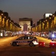 Police secure the Champs Elysee Avenue after one policeman was killed and another wounded in a shooting incident in Paris